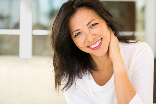 Middle Age Asian Woman Smiling from good visit to Dynamic Dental Care
